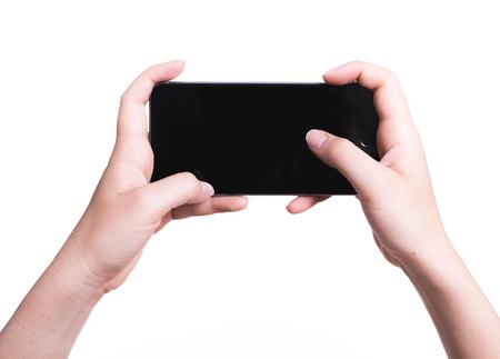 Foto de Female hand holding mobile smartphone play game gamer blank black screen isolated on over white background - Imagen libre de derechos