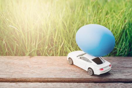 Photo for Easter egg and Car on garden grass background, Happy easter day concept - Royalty Free Image
