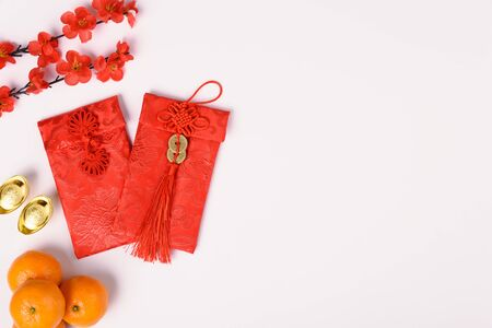 Photo pour Chinese new year festival concept, flat lay top view, Happy Chinese new year with Red envelope and gold ingot (Character FU means fortune, blessing) on white background with copy space for text - image libre de droit