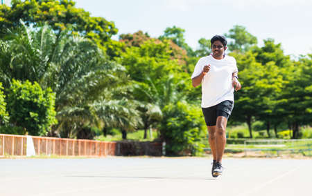 Foto de Asian young lifestyle athlete sport runner black man wear feet shoe active running training at the outdoor on the treadmill line road, healthy exercise workout - Imagen libre de derechos