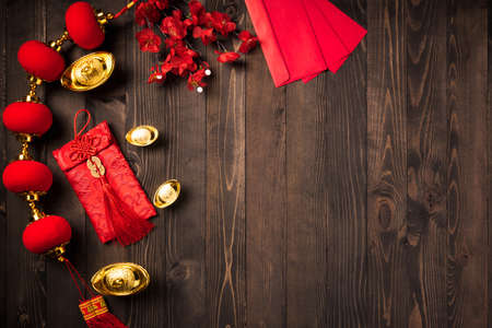 Photo for Chinese new year 2021 festival, Top view flat lay lunar new year or Happy Chinese new year decorations celebration with copy space on the wood background (Chinese character fu meaning fortune) - Royalty Free Image