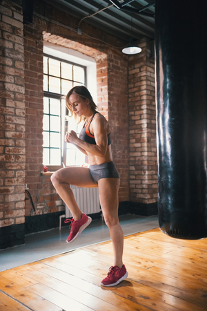 Photo pour An athlete woman running on the spot in the gym - image libre de droit