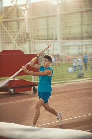 Foto per Pole vaulting training - young fit man about to jump - Immagine Royalty Free