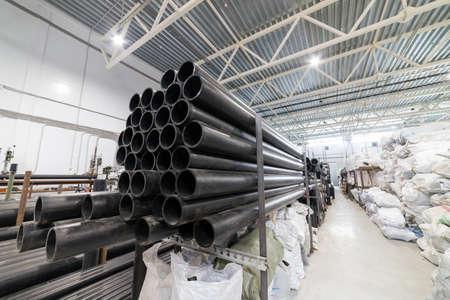 Foto für Black plastic tubes in the manufacturing centre - Lizenzfreies Bild