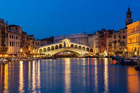 Night shot of the Rialto bridge Venice Italy