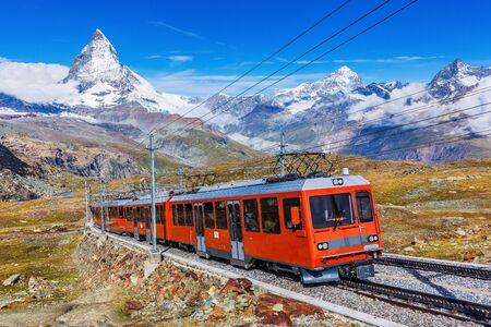 Photo pour Zermatt, Switzerland. Gornergrat tourist train with Matterhorn peak in the background. - image libre de droit