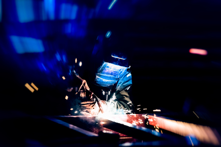 Foto de Welding at the industrial factory for steel production heavy industrial. add grain filter dark tone and motion for heavy work concept. - Imagen libre de derechos
