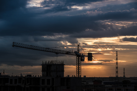 Photo pour Over view of tower crane in construction machine a sky background, especially in dim light. - image libre de droit