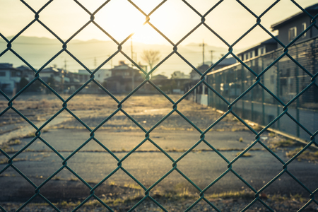 Photo for Cage or chain link fence for protection in park. add sunlight warm color tone vintage style - Royalty Free Image