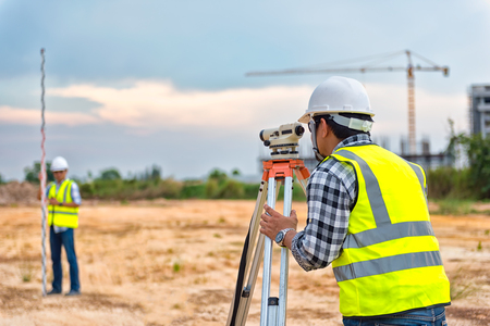 Photo for Surveyor equipment. Surveyor's telescope at construction site or Surveying for making contour plans are a graphical representation of the lay of the land before startup construction work - Royalty Free Image