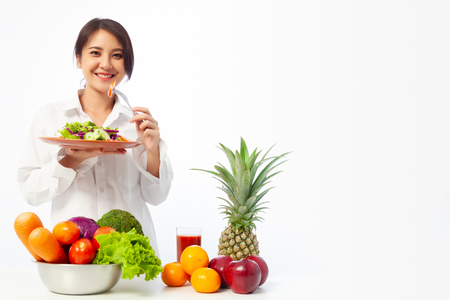 Photo for Asian young woman holding salad vegetables with fresh fruit and Healthy diet on the table. - Royalty Free Image