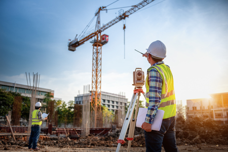 Photo pour Surveyor equipment. Surveyor's telescope at construction site or Surveying for making contour plans is a graphical representation of the lay of the land startup construction work. - image libre de droit