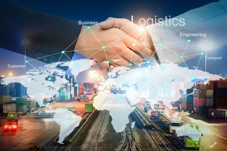 Photo pour Businessman people shaking hands on agreement of Beneficial for success in logistics with technology line on the world map about cargo transportation services, Import-Export management for logistics - image libre de droit