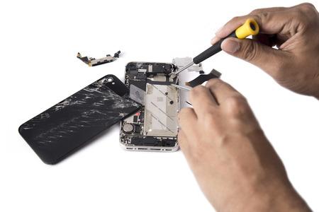 Photo pour Hand Phone Repair in home - image libre de droit