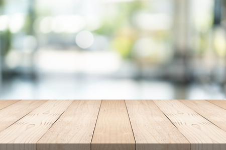 Photo for Empty brown wood table top on blur background at shopping mall, copy space for montage you product - Royalty Free Image