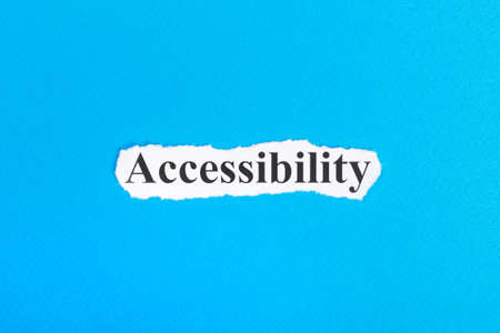 Accessibilit text on paper. Word Accessibilit on torn paper. Concept Image.