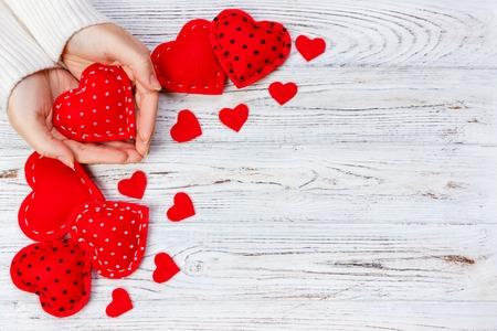 Photo pour Female hands hold red heart. Top view, copy space. - image libre de droit