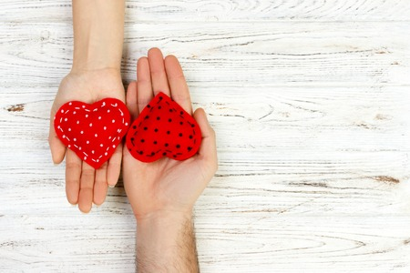 Photo pour Two hands with a heart on a white background. Valentine's Day copt space. - image libre de droit