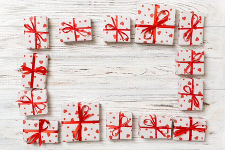 Foto de Frame of many Colorful gift boxes with red bow and heart blank copy space top view, Valentine or other holidays celebrations concept. - Imagen libre de derechos