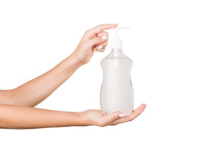 Photo for Female hand holding cream bottle of lotion isolated. Girl give cosmetic products on white background. - Royalty Free Image