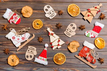 Foto de Top view of Christmas toys on wooden background. New Year ornament. Holiday concept. - Imagen libre de derechos