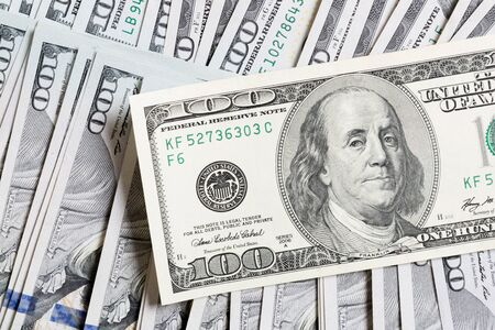 Photo pour US Dollar bills. one hundred dollar bills background. Top view of business concept on background with copy space. - image libre de droit