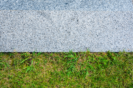 Gray Granite Pavement and Grass Lawn in Garden Decorative Texture