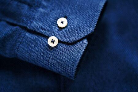 Photo pour Blue Shirt Sleeve with Buttons. Blue fabric texture. Tailor background - image libre de droit