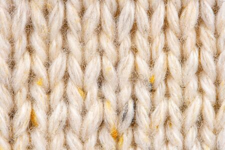Photo pour Texture of Wool Knit Beige Fabric Interspersed with Yellow Yarn. Sweater Background Close-Up View - image libre de droit