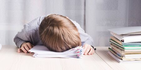 Photo pour Image of very tired schoolboy or student clutching his head - image libre de droit