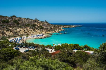 Foto de Beautiful beach  the sea. Seascape. Beautiful coast of Cyprus. Resort area in Cyprus. The Beaches Of Cyprus. Greek beaches. Paid beaches - Imagen libre de derechos