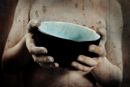 a grunge image of a young boy as he holds out an empty bowl