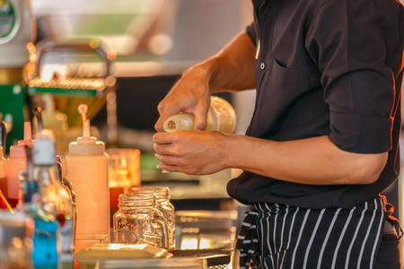Close up movement the hand bartenders in process of preparing cocktail and orange juice for customers who order from rooftop bar and restaurant.