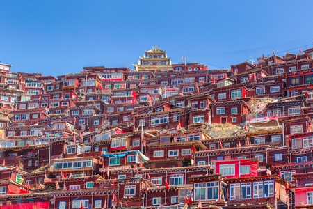 Top view monastery at Larung gar (Buddhist Academy) in sunshine day and background is blue sky, Sichuan, China
