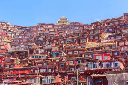 Red monastery and home at Larung gar (Buddhist Academy) in sunshine day and background is blue sky, Sichuan, China