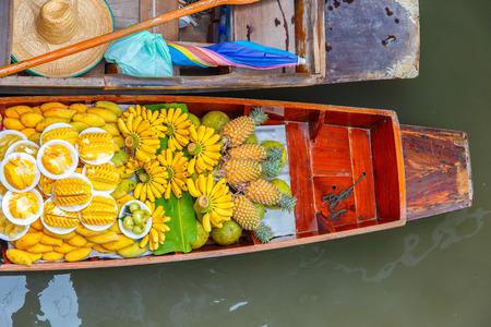 Long-tail boat with fruits on the floating market, Damnoen Saduak floating market in Ratchaburi near Bangkok, Thailand