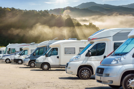 Photo pour Close up motorhomes parked in a row with fog in the morning background, Chiang Mai Province, Thailand - image libre de droit