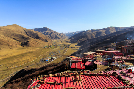 Top view monastery at Larung gar Buddhist Academy in a warm and foggy morning time, Sichuan, China