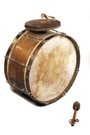 The old, worldly-wise, shabby, dusty bass drum for a wind band and a beater