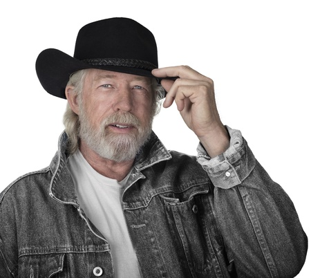 Handsome mature man wearing a gray jeans jacket and black felt cowboy hat with blue eyes