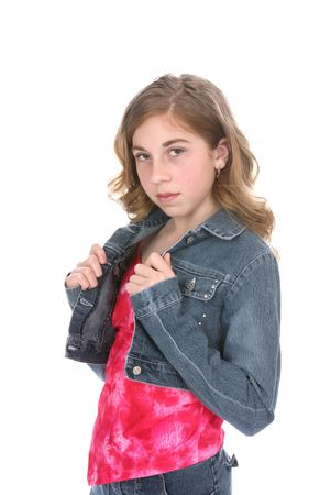Cute girl with a cropped denim jacket and bright pink shirt.