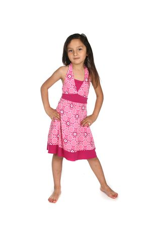pretty mixed race girl in patterned pink dress