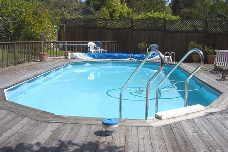 An above ground Doughboy swimming pool surrounded by decking.