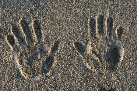 Hand prints on a cement sidewalk.