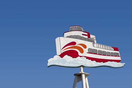 A funky old ferryboat sign