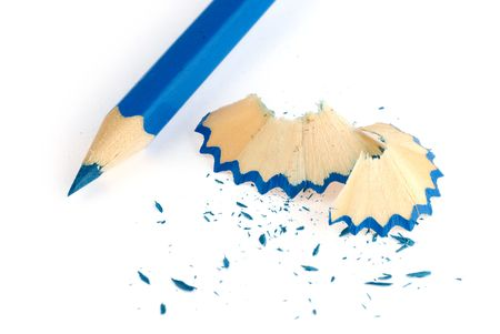blue pencil and shavings isolated on white background