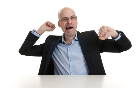 portrait of sleepy bald business man yawning - isolated