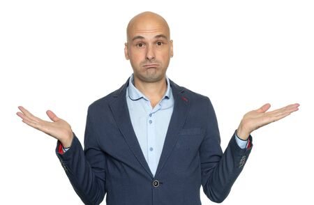 Bald man isolated on white background being at a loss, showing helpless gesture with hands. He does not know what to do. I don't know.