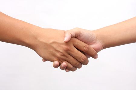 Photo pour Successful man and woman handshaking on white background - image libre de droit