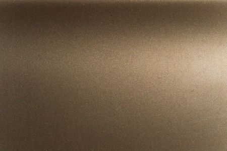 texture of a metal painted with bronze enamel